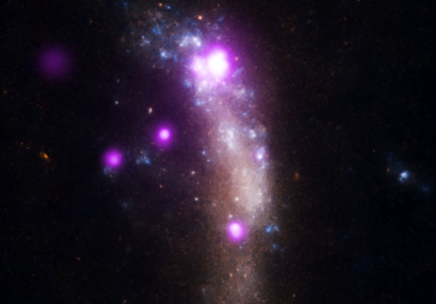 SN 2010jl is the large white spot at the top. Credit: X-ray: NASA/CXC/RCA CA/P.Chandra et al); Optical: NASA/STScI